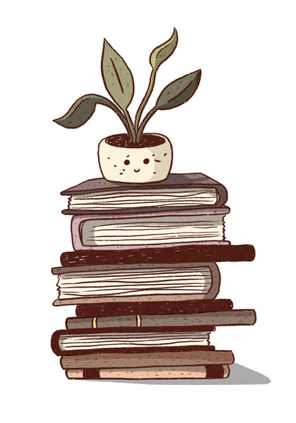 A little potted plant sitting on a stack of old books.