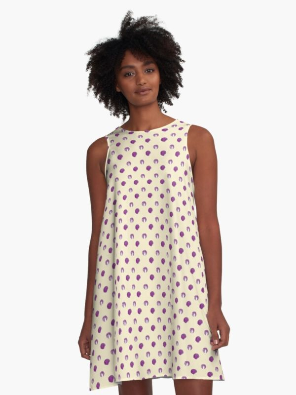 Cute dress printed with seamless pattern of red cabbage heads.