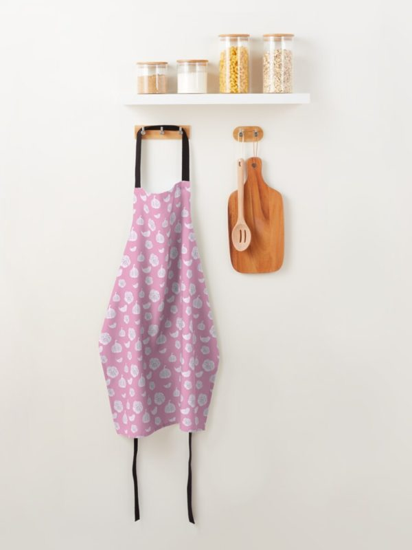 Pink apron with garlic pattern.
