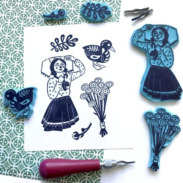 Handcarved stamps showing images related to the German Spreewalt region, including a girl in a traditional costume, a duck, and flowers.
